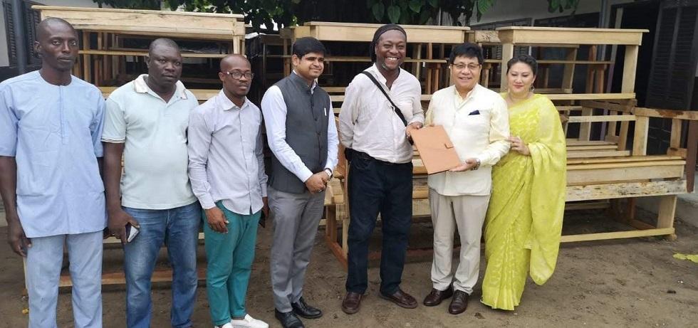 Gifting school furniture to Mahatma Ghandi School @ Yopougon