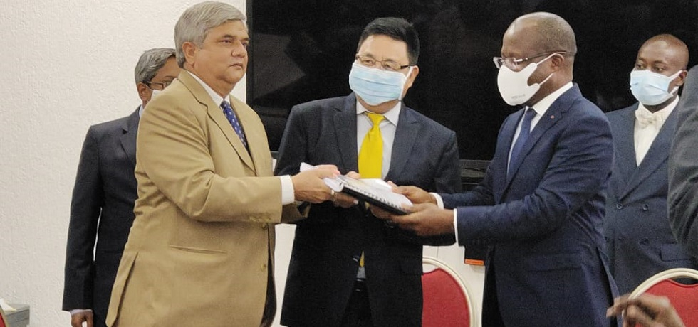 Minister of Health & Ambassador handing over the contract document for the rehabilitation of Health Centers